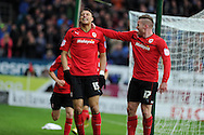 Cardiff city's Rudy Gestede (15) celebrates with Aron Gunnarsson (17) after he scores the opening goal. NPower championship, Cardiff city v Millwall at the Cardiff city stadium in Cardiff, South Wales on Saturday 29th Dec 2012. pic by Andrew Orchard, Andrew Orchard sports photography,