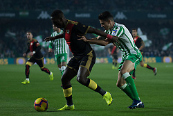 December 9, 2018 - Seville, Andalucía, Spain - Marc Bartra, Real Betis, and Adnvíncula, Rayo, fight for the ball during the LaLiga match between Real Betis and Rayo in Benito Villamarín Stadium (Seville) (Credit Image: © Javier MontañO/Pacific Press via ZUMA Wire)
