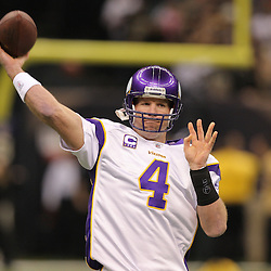Jan 24, 2010; New Orleans, LA, USA; Minnesota Vikings quarterback Brett Favre (4) throws a pass during warm ups prior to kickoff of the 2010 NFC Championship game at the Louisiana Superdome. Mandatory Credit: Derick E. Hingle-US PRESSWIRE