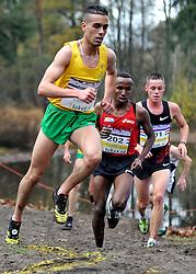 27-11-2011 ATLETIEK: NK CROSS 53e WARANDELOOP: TILBURG<br /> Khalid Choukoud die zijn cross-titel prolongeerde in 30:42. Rechts Abdi Nageeye (U23) AA Drink en Jesper van der Wielen (U23)<br /> ©2011-FotoHoogendoorn.nl
