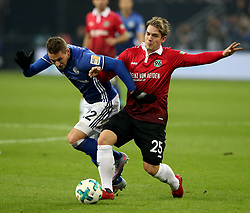 GELSENKIRCHEN, Jan. 22, 2018  Oliver Sorg (R) of Hannover and Marko Pjaca of Schalke battle for the ball during the Bundesliga match between FC Schalke 04 and Hannover 96 at Veltins-Arena in Gelsenkirchen, Germany, January 21, 2018. (Credit Image: © Joachim Bywaletz/Xinhua via ZUMA Wire)