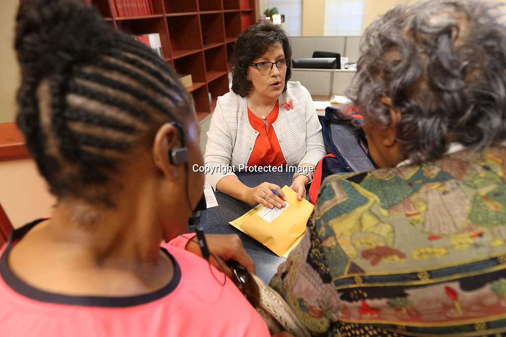 Missy Shelton, deputy clerk with the city of Tupelo, goes over an election packet with Vivian and Ophelene Moore, for their ward 7, precinct 12 location, at the Haven Acres Boys & Girls Club in Tupelo for Tuesday's primary election.