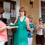 Best-selling author Nora Roberts draws a raffle ticket for fans to sit at her table during a book-signing lunch in historic Boonsboro, Maryland.