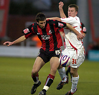 Photo: Matt Bright/Sportsbeat Images.<br /> AFC Bournemouth v Swindon Town. Coca Cola League 1. 29/12/2007.<br /> Simon Cox of Swindon is bullied off the ball by Jason Pearce of Bournemouth