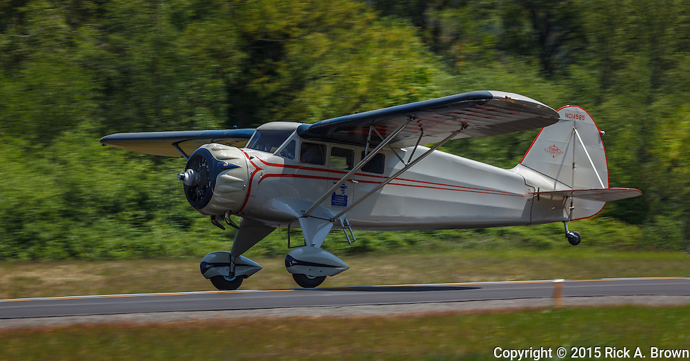 1934 Stinson Reliant SR-5E taking off.