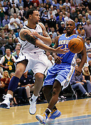 Utah Jazz guard Deron Williams, left, passes the ball as Denver Nuggets guard Chauncey Billups (1) defends during the second half of Game 3 of the NBA Western Conference first-round playoff series in Salt Lake City, Friday, April 23, 2010. Williams scored 24 points in the Jazz 105-93 win. (AP Photo/Colin Braley)
