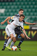 (L) Legia's Miroslav Radovic fights for the ball during the UEFA Europa League Group J football match between Legia Warsaw and Apollon Limassol FC at Pepsi Arena Stadium in Warsaw on October 03, 2013.<br /> <br /> Poland, Warsaw, October 03, 2013<br /> <br /> Picture also available in RAW (NEF) or TIFF format on special request.<br /> <br /> For editorial use only. Any commercial or promotional use requires permission.<br /> <br /> Mandatory credit:<br /> Photo by © Adam Nurkiewicz / Mediasport