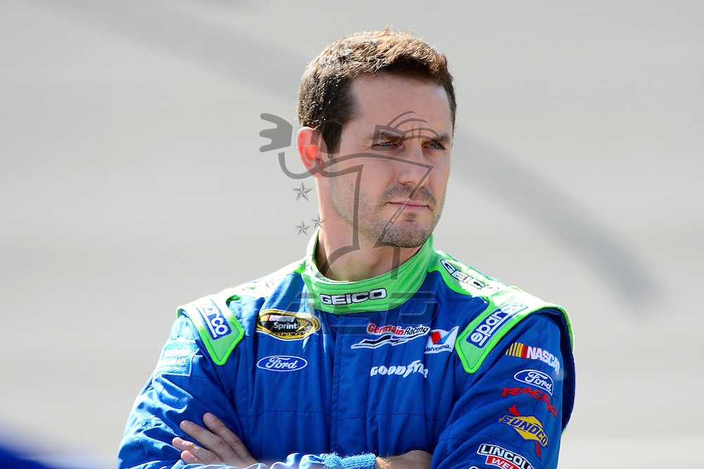 Brooklyn, MI  - Aug 17, 2012: Casey Mears (13) stands on pit row during qualifying for the Pure Michigan 400 at Michigan International Speedway in Brooklyn, MI.
