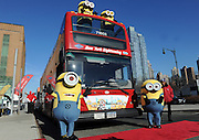 "The Minions are inducted into Gray Line Tours' ""Ride of Fame,"" Monday, Nov. 25, 2013, in New York, to celebrate the release of ""Despicable Me 2"" on Digital HD on November 26 and Blu-ray and DVD on December 10.  The Minions took over Manhattan in preparation for their appearance in the 84th annual Macy's Thanksgiving Day Parade.  (Photo by Diane Bondareff/Invision for Universal Studios Home Entertainment/AP Images)"