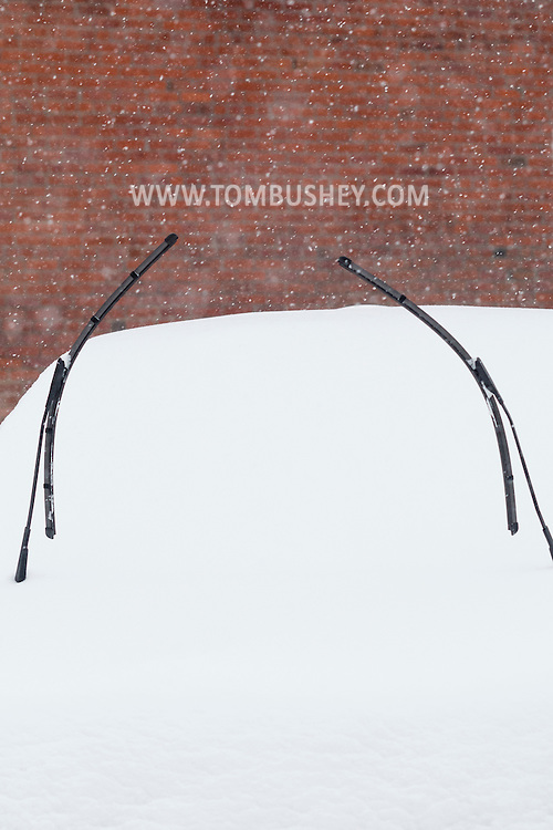 Middletown, New York - Windshield wipers on a car during a snowstorm on Feb. 9, 2017.