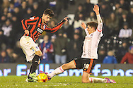 Emerson Hyndman of Fulham (right) tackles Joao Carlos of Brighton and Hove Albion (left) during the Sky Bet Championship match at Craven Cottage, London<br /> Picture by David Horn/Focus Images Ltd +44 7545 970036<br /> 29/12/2014