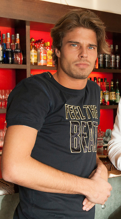 """Vujo Gavric sits at the bar in the restaurant 10' Dieci Al Lago, where he has a part time job, in Rapperswil, Switzerland, Wednesday, Nov. 11, 2009. According to the Swiss newspaper Blick Vujo Gavric will become the new bachelor in the TV show """"Bachelor"""" of Swiss private TV station 3+ which will air in autumn 2013. (Photo by Patrick B. Kraemer / MAGICPBK)"""