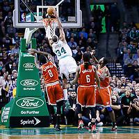 21 December 2012: Boston Celtics small forward Paul Pierce (34) goes for the dunk over Milwaukee Bucks center Larry Sanders (8) during the Milwaukee Bucks 99-94 overtime victory over the Boston Celtics at the TD Garden, Boston, Massachusetts, USA.