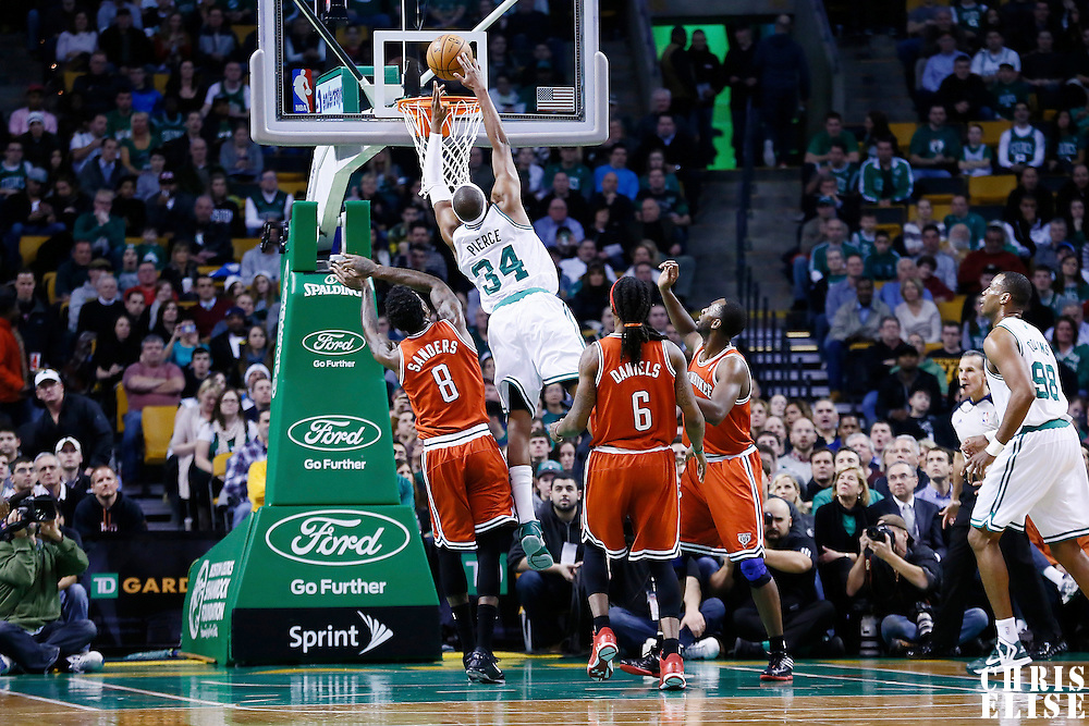 21 December 2012: Boston Celtics small forward Paul Pierce (34) goes for the dunk over Milwaukee Bucks center Larry Sanders (8) during the Milwaukee Bucks 99-94 overtime victory over the Boston Celtics at the TD Garden, Boston, Massachusetts, USA.