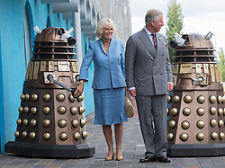 The Prince of Wales and The Duchess of Cornwall visit  the set of the BBC One drama series Doctor Who.<br /> In the picture - The Prince of Wales and the Duchess of Cornwall meet the Daleks, Cardiff, Wales, Wednesday July 3rd, 2013. Photo by i-Images