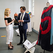 "11.06.2017         <br /> International award winning artists are among the almost 200 graduates of Limerick School of Art and Design who's work went on exhibition at the LSAD Graduate Show 2017.<br /> <br /> Pictured is 4th year graduating Fashion Design student, Fodhla McBride discussing her work titled 'Without Warning' with John Concannon, Director of Creative Ireland who officially opened the show.<br />  <br /> Students from the college took control of the over-riding message of this historical show as they conceptualised, designed and delivered on the theme - be.cause.<br />  <br /> The hypothesis conceived by Graphic Design graduates Cassandra Walsh and David Reilly, is derived from the fact the graduates have now reached a stage where they are confident with their work, their interpretations and creative solutions. As creative minds they have an innate need to ""do"" something. There is just this need to create, be.cause.<br /> . Picture: Alan Place."