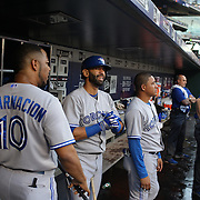 Jose Bautista, Toronto Blue Jays, with team mate Edwin Encarnacion, (left), in the dugout preparing to bat during the New York Mets Vs Toronto Blue Jays MLB regular season baseball game at Citi Field, Queens, New York. USA. 16th June 2015. Photo Tim Clayton