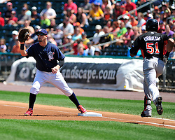 Tides Henry Urrutia gets tagged out at first base by IronPig Chris McGuiness. Philadelphia Phillies 2nd baseman Chase Utley rehabs with the Lehigh Valley IronPigs in a game against the Norfolk Tides August 2nd, 2015, at Coca-Cola Park in Allentown.
