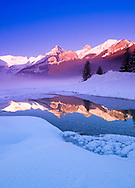 Sunset and reflection of winter mountains at Canada, Lake Louise