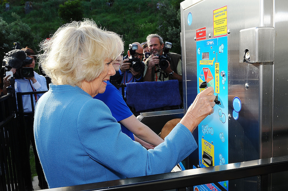 Camilla, Duchess of Cornwall visits the Wellington SPCA and puts a coin in the machine for the dog wash area, Wellington, New Zealand, Saturday, November 07, 2015. Credit:SNPA / Getty, Mark Tantrum **POOL**