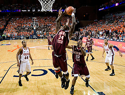 Virginia Tech forward/center Cheick Diakite (34) shoots against Virginia.  The Virginia Cavaliers men's basketball team fell to the Virginia Tech Hokies 70-69 in overtime at the John Paul Jones Arena in Charlottesville, VA on January 16, 2008.