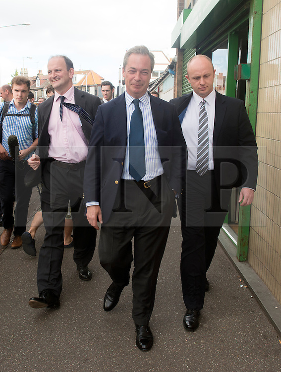 © Licensed to London News Pictures. 29/08/2014. Clacton-on-Sea, UK Douglas Carswell (L) and Nigel Farage (C), Leader of the UK Independence Party, UKIP, meet local people on a walk about in Clacton-on-Sea today 29th August 2014. Tory Douglas Carswell  defected to UKIP and quit as MP for Clacton, saying he will contest the subsequent by-election for Nigel Farage's party.. Photo credit : Stephen Simpson/LNP