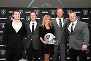 Jan 9, 2018; Alameda, CA, USA; Jon Gruden and wife Cindy Gruden pose with sons Deuce Gruden, Michael Gruden and Jon Gruden III pose at press conference after being introduced as Oakland Raiders head coach at the Raiders headquarters.