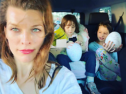"Milla Jovovich releases a photo on Instagram with the following caption: ""Happy Sunday everyone! Having such a great weekend with the kids. @chrissbrenner played the \u201cUncle\u201d card and spoiled them with a post Christmas present, so there were extra smiles to go around!\ud83e\udd17 #ladiary"". Photo Credit: Instagram *** No USA Distribution *** For Editorial Use Only *** Not to be Published in Books or Photo Books ***  Please note: Fees charged by the agency are for the agency's services only, and do not, nor are they intended to, convey to the user any ownership of Copyright or License in the material. The agency does not claim any ownership including but not limited to Copyright or License in the attached material. By publishing this material you expressly agree to indemnify and to hold the agency and its directors, shareholders and employees harmless from any loss, claims, damages, demands, expenses (including legal fees), or any causes of action or allegation against the agency arising out of or connected in any way with publication of the material."