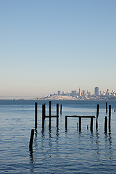 """Dock Pilings and San Francisco 2"" - This old dock pilings were photographed in Sausalito, San Francisco can be seen in the distance."