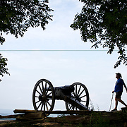 A visitor strolls by a cannon on Little Round Top, at Gettysburg National Military Park, on Sunday, June 30, 2013.  Little Round Top is the site of an unsuccessful Confederate assault that occurred on the second day of the Battle of Gettysburg, July 2, 1863.  The official Sesquicentennial Anniversary of the Battle of Gettysburg kicked off on Sunday, leading into a week full of demonstrations, reenactments and educational programs in and around Gettysburg, Pennsylvania.  A pivotal moment in the Civil War, over 50,000 soldiers were killed, wounded or missing after 3 days of battle from July 1-3, 1863.  Later that year, President Abraham Lincoln returned to Gettysburg to deliver his now famous Gettysburg Address to dedicate the cemetery there for the Union soldiers who died in battle.  John Boal photography