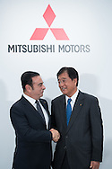 OCTOBER 20: Nissan Motor Co. CEO Carlos Ghosn, left, and Mitsubishi Motors Corp. President Osamu Masuko pose for photographers during a joint press conference in Tokyo, Thursday, Oct. 20, 2016. 20/10/2016-Tokyo, JAPAN