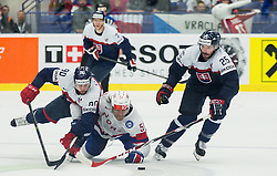Mats Rosseli Olsen of Norway between Tomas Tatar of Slovakia and Marek Viedensky of Slovakia during Ice Hockey match between Slovakia and Norway at Day 6 in Group B of 2015 IIHF World Championship, on May 6, 2015 in CEZ Arena, Ostrava, Czech Republic. Photo by Vid Ponikvar / Sportida