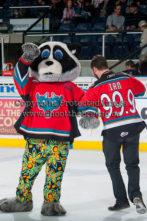 KELOWNA, CANADA - MARCH 18:  Rocky Racoon, the mascot of the Kelowna Rockets and Ian McKinnon, game host, dance a jig on the ice during intermission on March 18, 2015 at Prospera Place in Kelowna, British Columbia, Canada.  (Photo by Marissa Baecker/Shoot the Breeze)  *** Local Caption *** Rocky Racoon; Ian McKinnon;