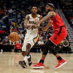 Oct 11, 2018; New Orleans, LA, USA; New Orleans Pelicans guard Elfrid Payton (4) is defended by Toronto Raptors guard Lorenzo Brown (4) during the second half at the Smoothie King Center. Mandatory Credit: Derick E. Hingle-USA TODAY Sports