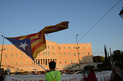 October 3, 2017 - Athens, Greece - A demonstrator waves a flag of Catalonia in Syntagma Square..Greek leftists demonstrate in Athens in support of the referendum in Catalonia and agianst the attack by the Spanish riot Police during the voting in Catalonia. (Credit Image: © George Panagakis/Pacific Press via ZUMA Wire)