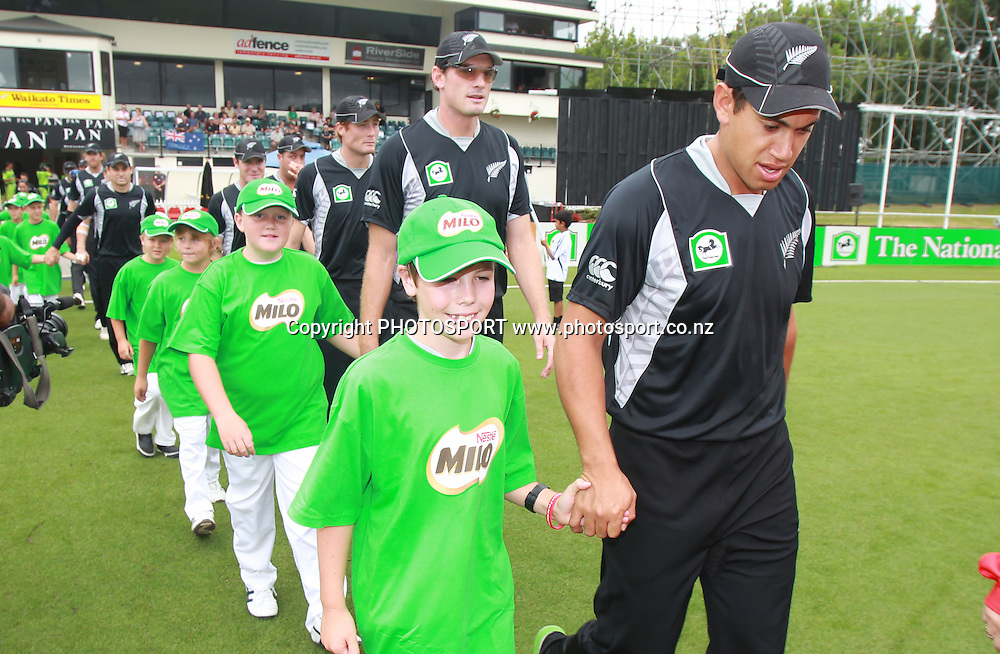 Ross Taylor leads the Milo klds onto the filed at the 5th ODI, Black Caps v Pakistan, One Day International Cricket. Seddon Park, Hamilton, New Zealand. Wednesday 3 February 2011. Photo: Andrew Cornaga/photosport.co.nz