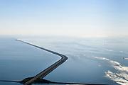 Nederland, Friesland, Gemeente Wonseradeel, 07-05-2018; Afsluitdijk ter hoogte van Kornwerderzand, gezien naar de kust van Noord-Holland.<br /> IJsselmeer en Waddenzee (rechts). Lorentzsluizen, spuisluizen.<br /> Enclosure Dam near the Frisian coast. Sluices and locks. RIght Waddenzee, IJsselmeer left.<br /> luchtfoto (toeslag op standard tarieven);<br /> aerial photo (additional fee required);<br /> copyright foto/photo Siebe Swart