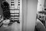 Deanna lurks around the corner while her mother, Shameka, cleans the bathroom.