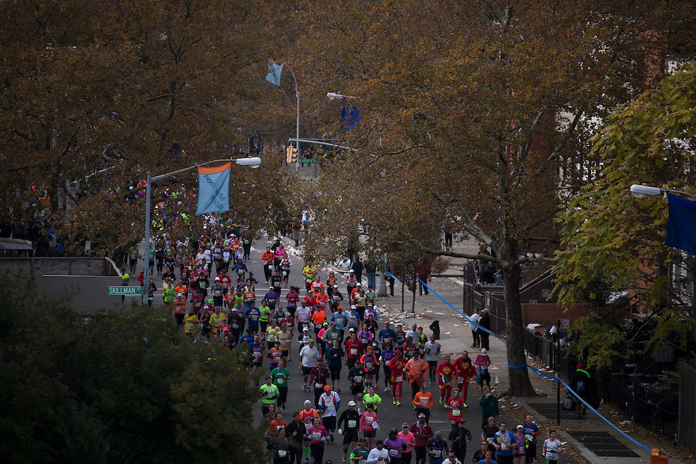 Participants run along Lafayette St in Bed-Stuy in the New York City Marathon in Brooklyn, NY on Sunday, Nov. 3, 2013.<br /> <br /> CREDIT: Andrew Hinderaker for The Wall Street Journal<br /> SLUG: NYSTANDALONE