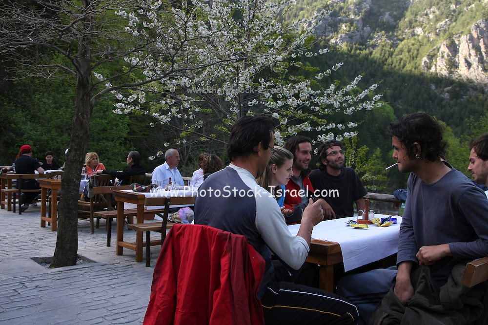 Greece, Macedonia, Mount Olympus National Park people at the outdoor cafe