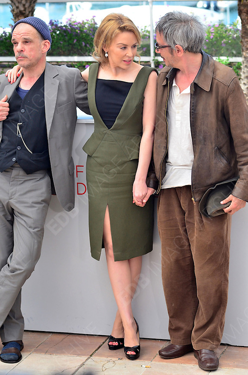 23.MAY.2012. CANNES<br /> <br /> DENIS LAVANT, LEOS CARAX AND KYLIE MINOGUE AT THE HOLY MOTORS PHOTOCALL DURING THE 65TH CANNES FILM FESTIVAL 2012, CANNES, FRANCE.<br /> <br /> BYLINE: EDBIMAGEARCHIVE.COM/JOE ALVAREZ <br /> <br /> *THIS IMAGE IS STRICTLY FOR UK NEWSPAPERS AND MAGAZINES ONLY*<br /> *FOR WORLD WIDE SALES AND WEB USE PLEASE CONTACT EDBIMAGEARCHIVE - 0208 954 5968*