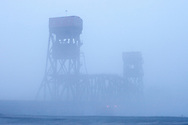 The Tazewell & Peoria's giant lift bridge over the Illinois River in Peoria, IL is shrouded in fog on a chilly winter day. Central Illinois has been experiencing wild temperature swings, leading to foggy days such as this.