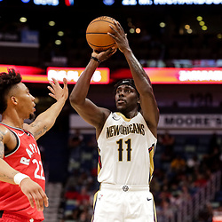 Oct 11, 2018; New Orleans, LA, USA; New Orleans Pelicans guard Jrue Holiday (11) shoots over Toronto Raptors guard Malachi Richardson (22) during the first half at the Smoothie King Center. Mandatory Credit: Derick E. Hingle-USA TODAY Sports