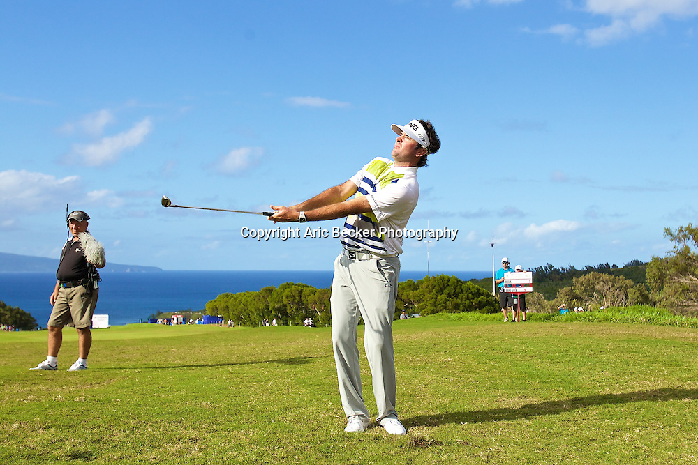 January 09 2015:  Bubba Watson hits his second shot just off he green on number fourteen during the First Round of the Hyundai Tournament of Champions at Kapalua Plantation Course on Maui, HI.
