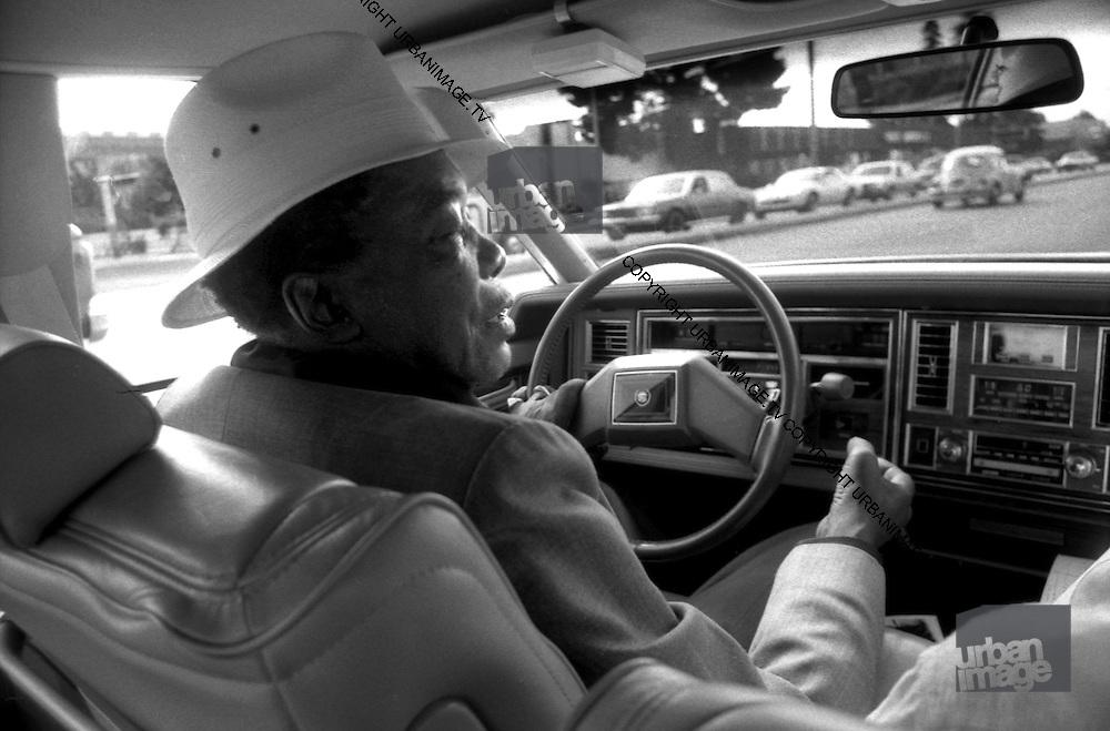 in his Cadillac, San Carlos CA  1985