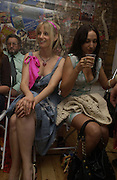 Fine Rees ( pink scarf)  and Deborah Polonsky , on right watching show. Intimates Spring Summer fashion show. charing X. 121-124 charing Cross Rd. London. 2 August 2005. ONE TIME USE ONLY - DO NOT ARCHIVE  © Copyright Photograph by Dafydd Jones 66 Stockwell Park Rd. London SW9 0DA Tel 020 7733 0108 www.dafjones.com