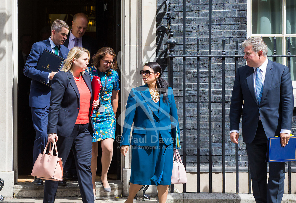 London, July 18th 2017. In a clear demonstration of unity with a cabinet that has seemed to be split over Brexit and other issues,  Government ministers, L-R Chief Whip (Parliamentary Secretary to the Treasury) Gavin Williamson, Transport Secretary Chris Grayling, Secretary of State for Culture, Media and Sport Karen Bradley, Lord Privy Seal and Leader of the House of Lords Baroness Natalie Evans , International Development Secretary Priti Patel and Minister of State for Immigration Brandon Lewis leave the last cabinet meeting together before the Parliamentary summer recess at Downing Street in London.