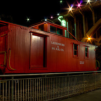 Train caboose sits on tracks besides Volunteer Landing in downtown Knoxville, Tn.