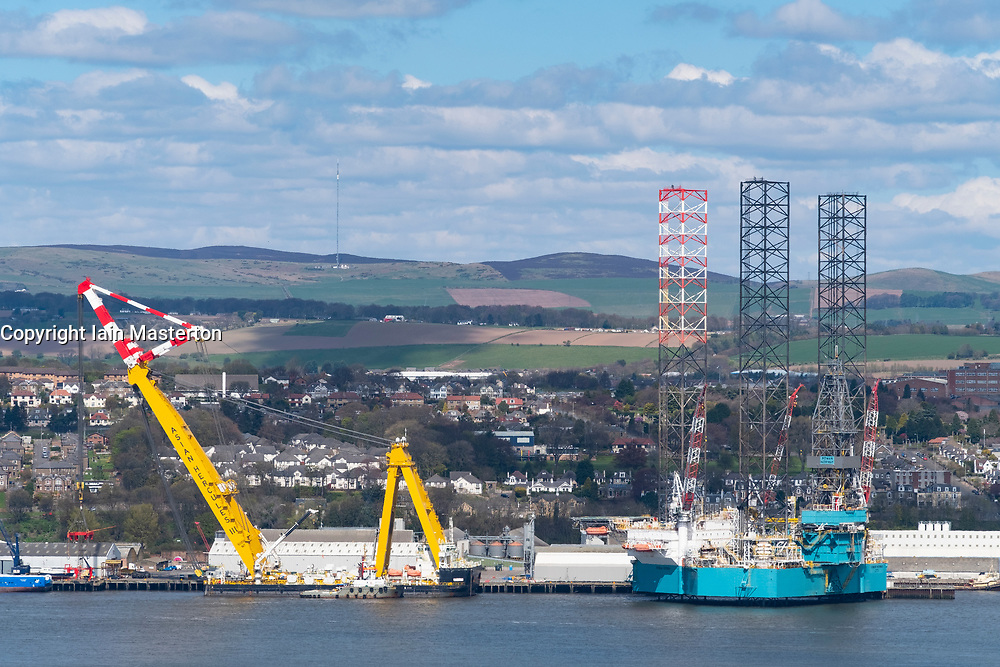 View over River Tay to city of Dundee and shipyards with offshore oil and gas vessels moored, in Tayside, Scotland, UK.