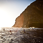 Kamanu Composites team members paddling near China Walls on Eastern Oahu near Honolulu, Hawaii.